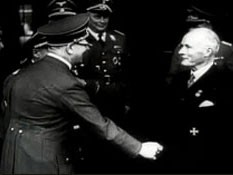 "<p>Hitler congratulates industrialist Gustav Krupp after presenting him with a Nazi party honor. After the ceremony, they toured a Krupp factory. This footage comes from the film ""The Nazi Plan,"" produced and used by the United States in the prosecution at the Nuremberg trials.</p>"
