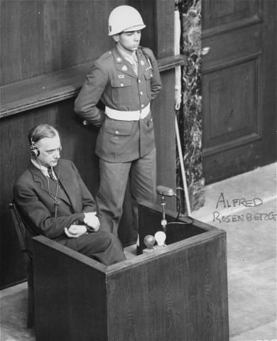 "<p>Former Nazi Party ideologist <a href=""/narrative/14991/en"">Alfred Rosenberg</a> on trial at the <a href=""/narrative/9366/en"">International Military Tribunal</a> war crimes trial. Nuremberg, Germany, April 15, 1946.</p>"