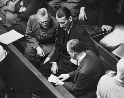 <p>Defendants Wilhelm Keitel (left), Ernst Kaltenbrunner (middle), and Alfred Rosenberg (right), talk during a recess in the proceedings at the International Military Tribunal trial of war criminals at Nuremberg. Nuremberg, Germany, 1945–1946.</p>