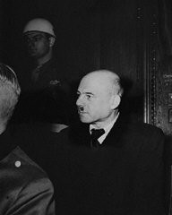 """<p>Fritz Sauckel follows the proceedings of the <a href=""""/narrative/9366/en"""">International Military Tribunal</a> trial of war criminals at Nuremberg. He was found guilty of war crimes and crimes against humanity and was sentenced to death. Photograph taken in Nuremberg, Germany, betweenNovember 20, 1945, and October 1, 1946.</p>"""