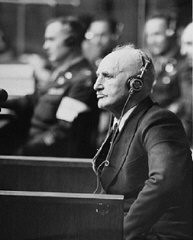 "<p>Defendant <a href=""/narrative/10706/en"">Julius Streicher</a>, editor of the antisemitic newspaper Der Stürmer, on the stand at the International Military Tribunal trial of major war criminals at Nuremberg. April 29, 1946.</p>"