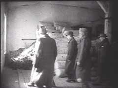 <p>Upon arrival in the Auschwitz camp, victims were forced to hand over all their belongings. Inmates' belongings were routinely packed and shipped to Germany for distribution to civilians or use by German industry. The Auschwitz camp was liberated in January 1945. This Soviet military footage shows civilians and Soviet soldiers sifting through possessions of people deported to the Auschwitz killing center.</p>