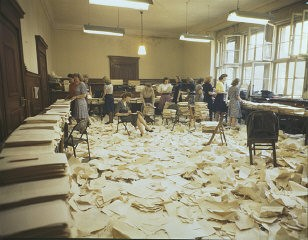 "<p>View of the mimeograph room in the Palace of Justice at Nuremberg after the transcripts on the sentencing of the defendants in the <a href=""/narrative/9582/en"">High Command Case</a> had been run off. The reproduction of documents during the Nuremberg trials, often in four languages, was a huge logistical challenge. Nuremberg, Germany, 1948. (Source record ID: A65III/RA-121-D)</p>"