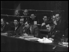 <p>This film clip shows translators in action at the Nuremberg trial. English, French, Russian, and German were the official languages of the Nuremberg trials. Interpreters provided simultaneous translations of the court proceedings which were then available to the trial participants via headphones.</p>