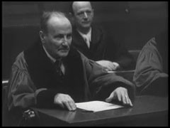 <p>This film clip shows the use of headphones at the International Military Tribunal. English, French, Russian, and German were the official languages of the Nuremberg trials. Translators provided simultaneous translations of the proceedings. Each participant in the trial had a set of headphones.</p>