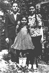 "<p>A brother and sisters, members of a Jewish family. One of the sisters pictured here, along with other family members, did not survive the <a href=""/narrative/72/en"">Holocaust</a>. Nove Zamky, <a href=""/narrative/7295/en"">Czechoslovakia</a>, May 1944.</p>"
