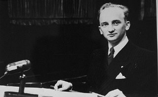 "<p>Chief Prosecutor Benjamin Ferencz at the Einsatzgruppen Trial, <a href=""/narrative/9545/en"">Case #9 of the Subsequent Nuremberg Proceedings</a>. Photograph taken in Nuremberg, Germany, between July 29, 1947, and April 10, 1948.</p>"