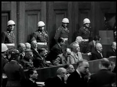 "<p>The film ""Nazi Concentration Camps"" was presented in the courtroom on November 29, 1945, and entered as evidence in the trial. It was filmed as Allied troops liberated the concentration camps. This clip shows the reactions of defendants and others in the courtroom following the screening of the film.</p>"
