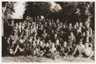 "<p>Group portrait of Jewish displaced youth at the OSE (Oeuvre de Secours aux Enfants) home for Orthodox Jewish children in Ambloy. <a href=""/narrative/10130/en"">Elie Wiesel</a> is among those pictured. Ambloy, France, 1945.</p>"