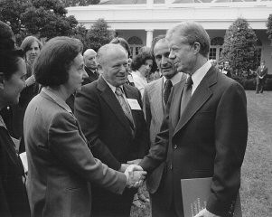 "<p>Vladka Meed shakes the hand of President Jimmy Carter at a White House Rose Garden ceremony. The ceremony marked the official presentation of the report of the US Holocaust <a href=""/narrative/10503/en"">Commission</a> to the president by commission chairman <a href=""/narrative/10130/en"">Elie Wiesel</a> (second from right, with Benjamin Meed, center). Washington, DC, September 27, 1979.</p>"