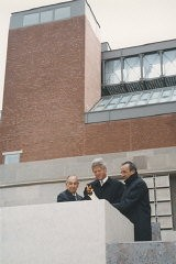 "<p>President Bill Clinton (center), Elie Wiesel (right), and Harvey Meyerhoff (left) light the eternal flame outside on the Eisenhower Plaza during the dedication ceremony of the <a href=""/narrative/7511/en"">United States Holocaust Memorial Museum</a>. April 22, 1993.</p>"