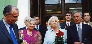 """<p>Elie Wiesel with his wife Marion and President Ion Iliescu in Sighet following the presentation of the Final Report of the International Commission on the Holocaust in Romania.</p> <p>Learn more about <a href=""""https://www.ushmm.org/research/scholarly-presentations/symposia/holocaust-in-romania/romania-facing-its-past"""" target=""""_blank"""" rel=""""noopener noreferrer"""">Romania facing its past</a>.</p>"""