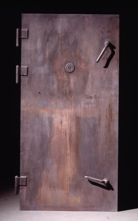 "<p>This casting of a gas chamber door in the <a href=""/narrative/3168/en"">Majdanek</a> camp, near Lublin, Poland, was commissioned by the United States Holocaust Memorial Museum. Each gas chamber in Majdanek was fitted with an airtight metal door and was bolted shut before gas entered the chamber inside. SS guards could observe the killing process through peepholes in the upper center of the door.</p>"
