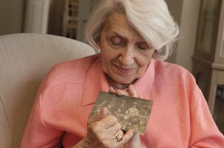 <p>This picture, taken in 2004, shows Blanka Rothschild holding one of her prewar family photographs.</p>