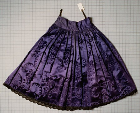"<p>This taffeta and cotton skirt dates from the 1920s. It belonged to a Romani (Gypsy) woman who was born in Frankfurt, Germany, and who lived in Germany before the war. She was arrested by the Nazis and interned in the <a href=""/narrative/3673/en"">Auschwitz</a>, <a href=""/narrative/4015/en"">Ravensbrück</a>, <a href=""/narrative/3880/en"">Mauthausen</a>, and <a href=""/narrative/4549/en"">Bergen-Belsen</a> camps. She died in <a href=""/narrative/4549/en"">Bergen-Belsen</a> in March 1945, shortly before the camp's liberation. Her husband and two of her six children were also killed in the camps.</p>"