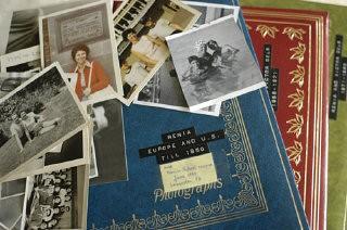 "<p>Stack of <a href=""/narrative/10466/en"">Regina Gelb</a>'s photographs and albums. 2004.</p>"
