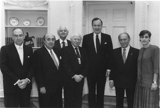 """<p>Members of the United States Holocaust Memorial Council pose with President George Bush (third from right) on the occasion of the 1989 Days of Remembrance. <a href=""""/narrative/10553/en"""">Benjamin Meed</a> is fourth from the right. Washington, DC, 1989.</p> <p>Learn more about <a href=""""https://www.ushmm.org/remember/days-of-remembrance"""" target=""""_blank"""" rel=""""noopener noreferrer"""">Days of Remembrance</a>.</p>"""
