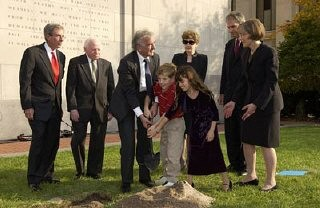 <p>Benjamin Meed, Elie Wiesel (second and third from left), and two children bury a time capsule during the Tribute to Holocaust Survivors: Reunion of a Special Family, one of the Museum's tenth anniversary events. Washington, DC, November 2003.</p>