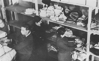 <p>An American Jewish Joint Distribution Committee (JDC) clothing supply center for refugees. Vilna, Lithuania, 1940.</p>