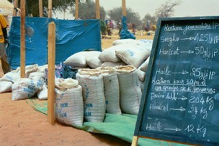 <p>Relief supplies in a refugee camp in eastern Chad for refugees from the Darfur region of neighboring Sudan. Jerry Fowler, Staff Director of the Museum's Committee on Conscience, visited in May 2004 to hear firsthand the refugees' accounts of the genocidal violence they faced and of being driven into the desert.</p>