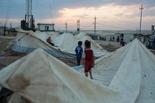 <p>Refugee boys from Syria play on old tents in the Domiz refugee camp outside Duhok, Iraqi Kurdistan. September 5, 2015.</p>