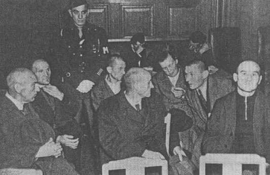 "<p>Staff from the <a href=""/narrative/8116/en"">Hadamar</a> euthanasia center, including senior physician Adolf Wahlmann (front, left), during their trial. Wiesbaden, Germany, October 8-15, 1945.</p>"