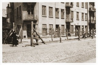 "<p>View of the entrance to the ""Gypsy camp"" on Brzezinska Street in the <a href=""/narrative/2152/en"">Lodz</a> ghetto in occupied Poland. Photograph taken in 1942. </p>"