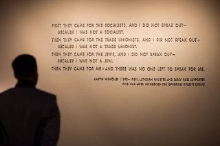 """<p>A visitor stands in front of the <a href=""""/narrative/271/en"""">quotation</a> from <a href=""""/narrative/10764/en"""">Martin Niemöller</a> that is on display in the Permanent Exhibition of the United States Holocaust Memorial Museum. Niemöller was a Lutheran minister and early Nazi supporter who was later imprisoned for opposing Hitler's regime.</p>"""