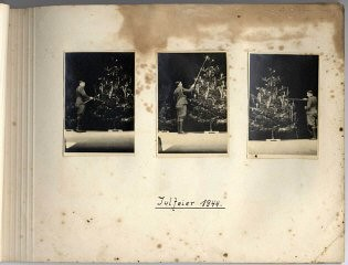 "<p>Page from Karl Höcker's <a href=""/narrative/10865/en"">album</a>, with the caption ""Yuletime, 1944."" The photographs show Karl Höcker lighting the candles on the Yule tree. 1944.</p>"
