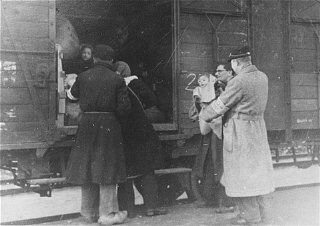 "<p>Deportation from the <a href=""/narrative/4469/en"">Westerbork</a> transit camp. Members of the Jewish police are seen in the photograph. The Netherlands, 1943–44.</p>"