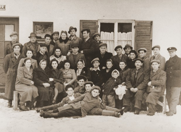 """<p>Group portrait of former Bielski partisans from Nowogrodek taken in the <a href=""""/narrative/9339/en"""">Foehrenwald</a> displaced persons camp. Germany, April 3, 1948.</p>"""