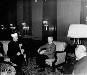 <p>The former Mufti of Jerusalem, Hajj Amin al-Husayni, meets Hitler for the first time. Berlin, Germany, November 28, 1941.</p>