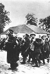 <p>A column of prisoners arrives at the Belzec killing center. Belzec, Poland, ca. 1942.</p>