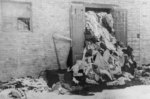 """<p>One of many warehouses at <a href=""""/narrative/3673/en"""">Auschwitz</a> in which the Germans stored clothing belonging taken from victims of the camp. This photograph was taken after the <a href=""""/narrative/2317/en"""">liberation</a> of the camp. Auschwitz, Poland, after January 1945.</p>"""