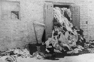 "<p>One of many warehouses at <a href=""/narrative/3673/en"">Auschwitz</a> in which the Germans stored clothing belonging taken from victims of the camp. This photograph was taken after the <a href=""/narrative/2317/en"">liberation</a> of the camp. Auschwitz, Poland, after January 1945.</p>"