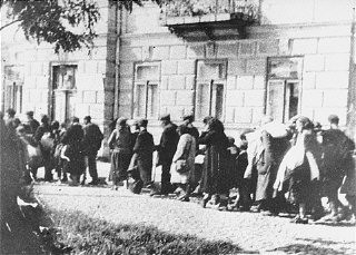 <p>Jews assembled in the Siedlce ghetto during a deportationare forced to march toward the railway station. Siedlce, Poland, August 21–24, 1942.</p>