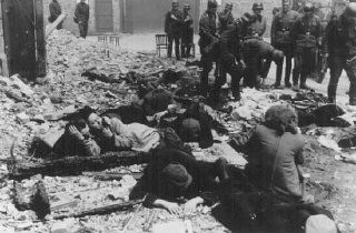 "<p>German soldiers capture Jews hiding in a bunker during the <a href=""/narrative/3636/en"">Warsaw ghetto uprising</a>. Warsaw, Poland, April–May 1943.</p>"