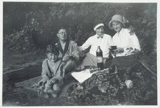 """<p>Fritz Glueckstein (left) on a picnic with his family in Berlin, Germany, 1932. Fritz's father was Jewish—he attended services in a liberal synagogue—and his mother was Christian. Under the <a href=""""/narrative/11475/en"""">Nuremberg Laws</a> of 1935, Fritz would be classified as mixed-raced (<em>Mischling</em>), but since his father was a member of the Jewish religious community, Fritz was classified as a Jew.</p>"""