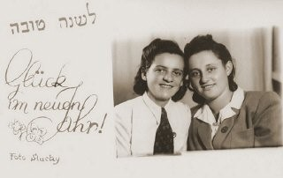 "<p>A Jewish New Year greeting card from Hela Brett, the donor's friend. In the winter of 1945-46, Rochelle Shulman (born Rochelle Szklarski), her father, and sisters left Poland with the help of the <a href=""/narrative/5217/en""><em>Brihah</em></a>. They reached the <a href=""/narrative/11688/en"">Bad Reichenhall</a> displaced persons camp and stayed there until February 1949, when they sailed to New York aboard the SS <em>Marine Shark</em>. Bad Reichenhall, Germany, September 1947.</p>"