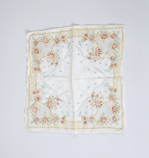 <p>A red and yellow floral handkerchief belonging to Judit Gondos that she took with her when she left Budapest on the Kasztner rescue train.</p>
