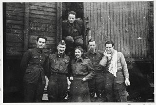 <p>Six members of the Anders Army pose in front of a railcar prior to their departure for Iran. Krasnovodsk, Soviet Union, February 21, 1942.</p>