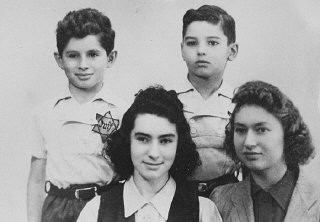 "<p>The Margules children wearing Jewish badges. Originally from Warsaw, the Margules family settled in <a href=""/narrative/6033/en"">Paris</a> in the 1930s. Three of the children were deported and killed in 1942. Only one daughter (pictured at the bottom right) survived the war. Paris, France, 1941.</p>"