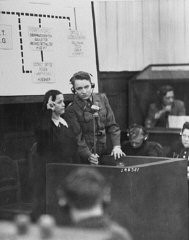 "<p>A Czech woman who witnessed the Nazi massacre of the male inhabitants of Lidice is sworn in at the <a href=""/narrative/9532/en"">RuSHA trial</a> in Nuremberg, case #8 of the <a href=""/narrative/9461/en"">Subsequent Nuremberg Proceedings</a>. Germany, October 30, 1947.</p>"