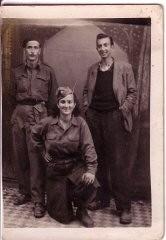 """<p><a href=""""/narrative/11886/en"""">Sara Fortis</a>, center, in partisan uniform.</p>"""