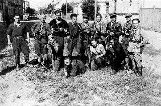 <p>Benjamin Levin (bottom left kneeling) and his partisan group at the liberation of Vilna.</p>