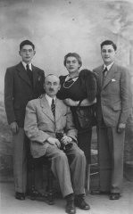 """<p><a href=""""/narrative/11941/en"""">Walter Marx</a> (standing at left) with father Ludwig, mother Johanna, and cousin Werner. In 1944, Walter joined partisans in Italy. He was the only one in the photograph to survive the Holocaust.</p>"""