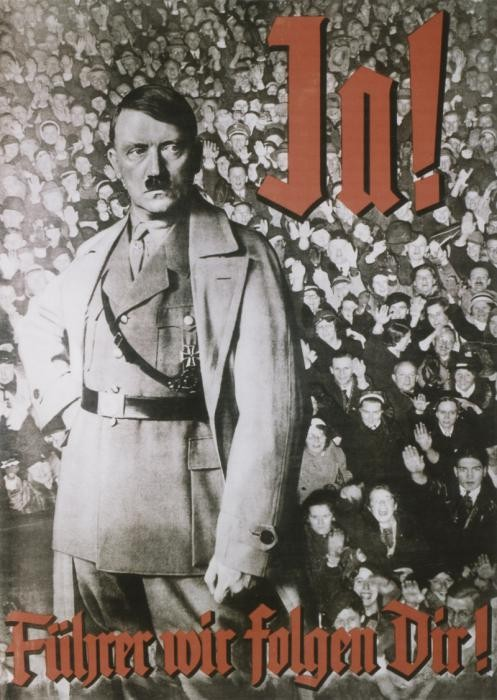 """<p>Nazi propaganda constantly reinforced the notion that Hitler was the embodiment of the national will. Here, a determined looking Hitler in military dress stands with clenched fist, poised for action above the adoring crowd. The text on the poster says """"Yes! Leader, We Follow You!"""" (Ja! Führer wir folgen Dir!)</p> <p>This poster, designed for a <a href=""""/narrative/11034/en"""">1934</a> public referendum on uniting the posts of German chancellor and president, conveys unanimous popular support for Hitler.</p>"""