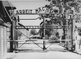 "<p>View of the main entrance to the Auschwitz camp. The sign above the gate says ""Arbeit Macht Frei"" (Work makes one free). Auschwitz, Poland, date uncertain.</p>"