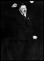 "<p>Hitler rehearsing his oratory. Hitler carefully cultivated his image as the Nazi Party leader as he came to see the propagandistic value of photographic publicity. Heinrich Hoffmann, Hitler's official photographer, created the images central to the growing ""Führer cult."" In 1927, Hoffmann snapped these action shots of Hitler rehearsing his oratory.</p>"
