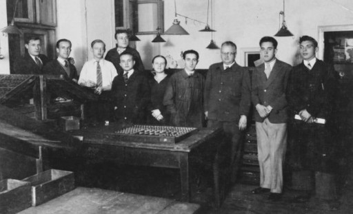 Polish and Jewish workers in a printing press in Kalisz, Poland, 1932.